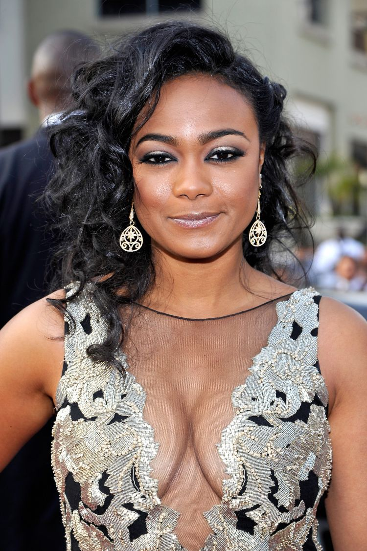 an image of tatyana ali in a dress